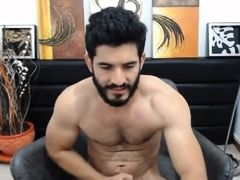 Bearded gay hunk masturbates on cam