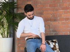 Beautiful gay Alexis Belfort masturbates on sofa