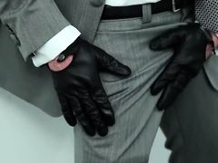 Gay hunk in leather gloves jerks