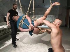 muscled stud tied-up and his cock milked