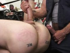 gay slave is tied up by mechanics