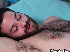 Jock sucking thick cock of bearded stud