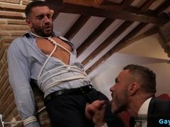 Muscle gay bound by hunk in suit with facial