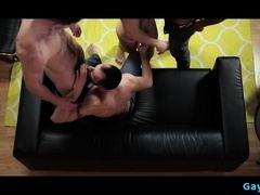 Muscle gay foursome with anal cumshot on black sofa
