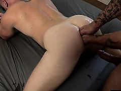 Tattoo jock double fisting with cumshot