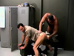 Two attractive cops having fun with a big sex toy in the locker room
