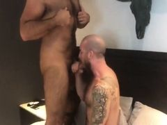 Tattooed muscle gay sucks bear man